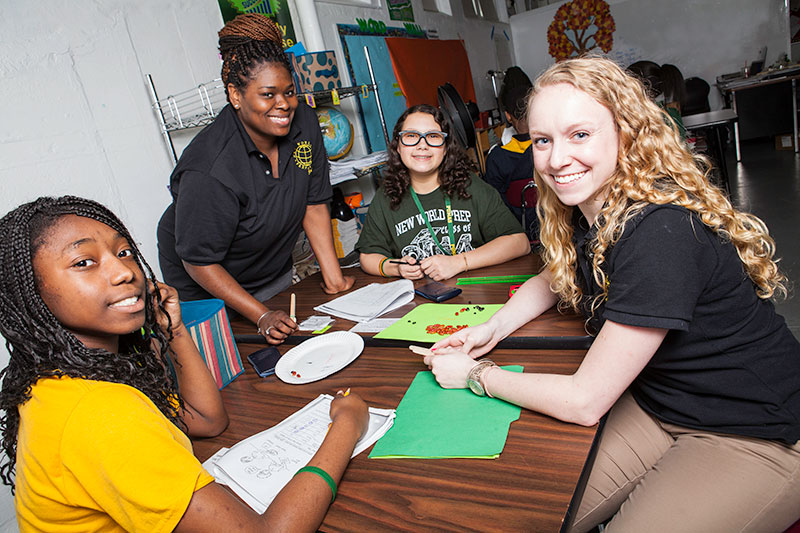 Equisha Newsome and Rachel Tripp '12 M '13, seen here with students Breanna Mitchell and Juliana Rosen, teach science at New World Preparatory Charter School.