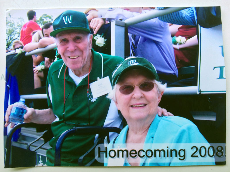 Bunny Barbes and Mary Boody in the stands at Homecoming in 2008.