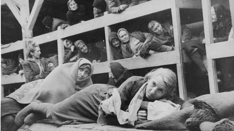 Prisoners in the overcrowded barracks in Auschwitz. Copyright The United States Holocaust Museum.
