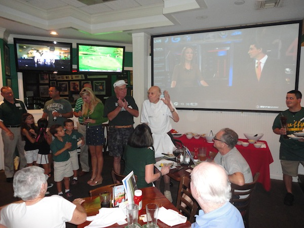 Bunny Barbes waves to a crowd of Wagner fans at the football season opener, August 31, 2012, in Boca Raton, Florida.