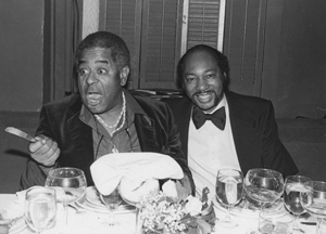 Dizzy and Paul sitting at a banquet table