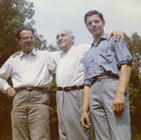 George Laszlo '72 stands with his uncle and father outdoors in a vintage photo from 1964.