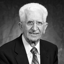 black and white photo of Dr. Accettola