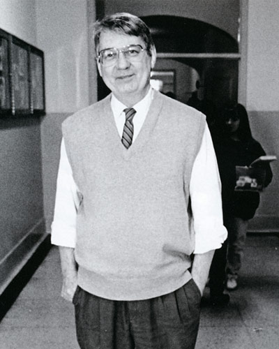 Professor Lewis J. Hardee Jr. stands in a hallway of Main Hall.