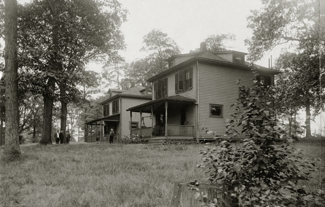 A black-and-white photograph of two houses.