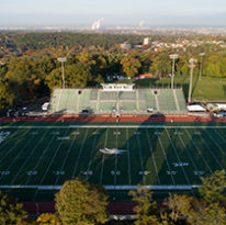 Football field and stadium viewed from above.